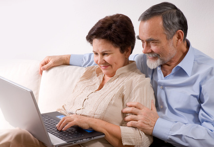 Senior couple on laptop. Concept may be is shopping in internet